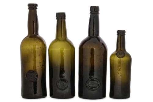 FOUR SEALED WINE BOTTLES