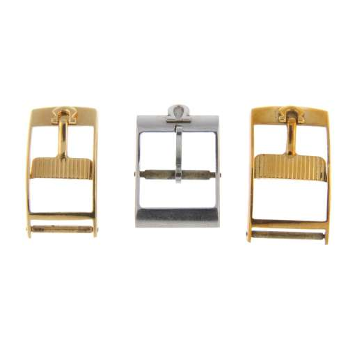 OMEGA - a group of three pin buckles, to include stainless steel and gold plated examples.