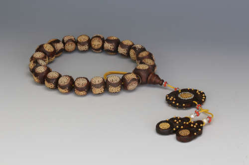 A Chinese Carved Agarwood Prayers Beads