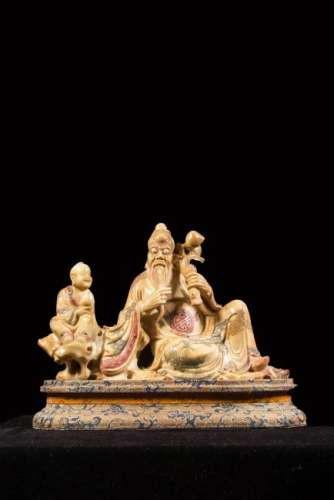 A SOAPSTONE CARVING OF SHOULAO AND ATTENDANT.ANTIQUE