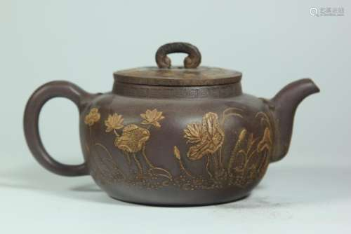 A CARVED YIXING TEAPOT AND COVER.ANTIQUE