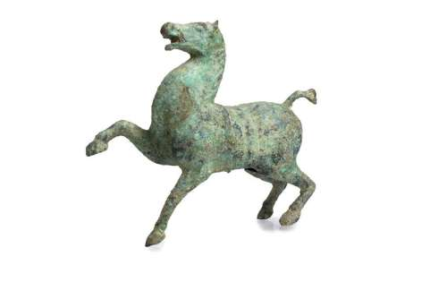 AN ARCHAIC BRONZE MODEL OF A HORSE China, probably Han