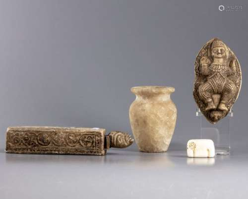 Four ancient stone carvings of marble and albaster