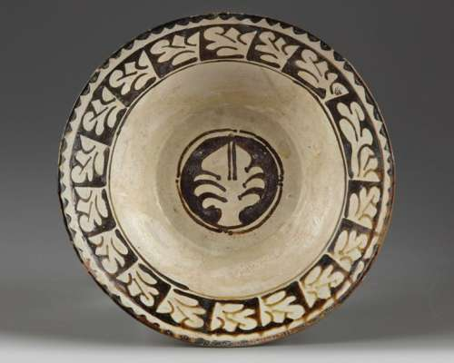 A slip painted islamic pottery bowl