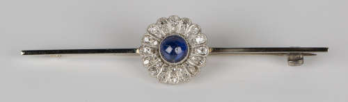 A cabochon sapphire and diamond bar brooch in the form of a flowerhead shaped cluster, mounted