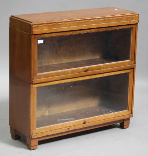 An Art Deco oak Globe Wernicke two-section glazed cabinet, on block legs, height 84cm, width 85cm,