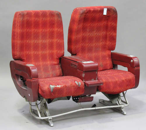 A mid/late 20th century Air France two-person aeroplane seat, finished in red, on cast metal base,