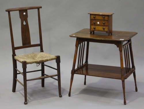An early 20th century Arts and Crafts style walnut two-tier occasional table, height 65cm, width