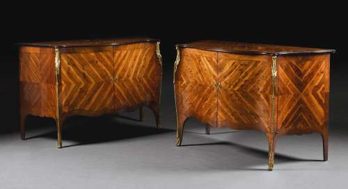 A pair of George III gilt-bronze mounted yew-wood commodes, circa 1765-1770, attributed to Mayhew and Ince