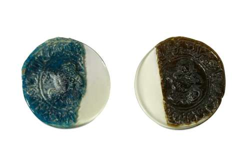 TWO FRAGMENTS OF HOT-WORKED GLASS MEDALLIONS Central
