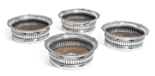 A set of four George III silver wine coasters, Paul Storr of Storr & Co. for Rundell, Bridge & Rundell,  London, 1818