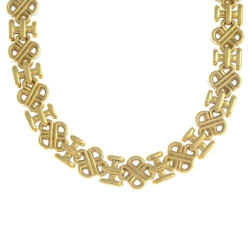 An 18ct gold necklace. The openwork knot motif links,