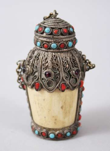 A 19TH CENTURY SINO - TIBETAN BONE INLAID SNUFF BOTTLE, the body of the snuff bottle formed bone