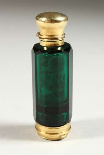 A VICTORIAN GREEN GLASS FACET CUT DOUBLE ENDED SCENT BOTTLE AND VINAIGRETTE. 8cms long.