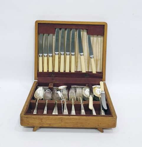 Service of Friar EPNS table flatware with angular embossed handles, in oak canteen