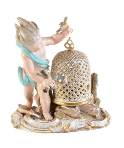 A Meissen model of a putto emblematic of Air from a series of the Elements