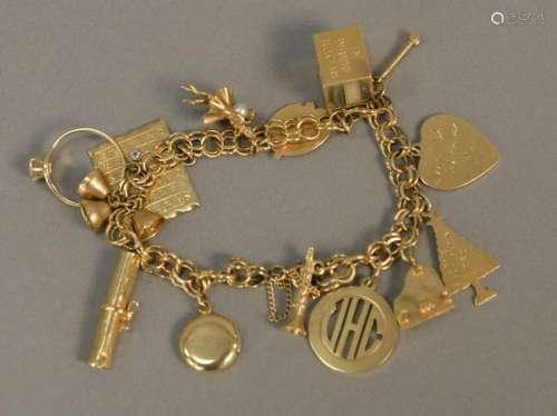 14K gold charm bracelet with 14K gold charms, 34.7 gr.