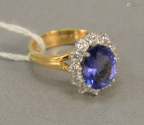 18K gold ring set with oval center Tanzanite surrounded