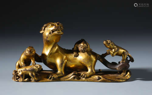 A Rare Chinese Carved Gilt Bronze Lion Brush Rest of Lion Group
